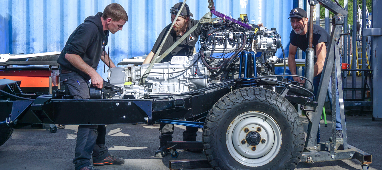 A Defender chassis with LS3 Corvette engine being fitted