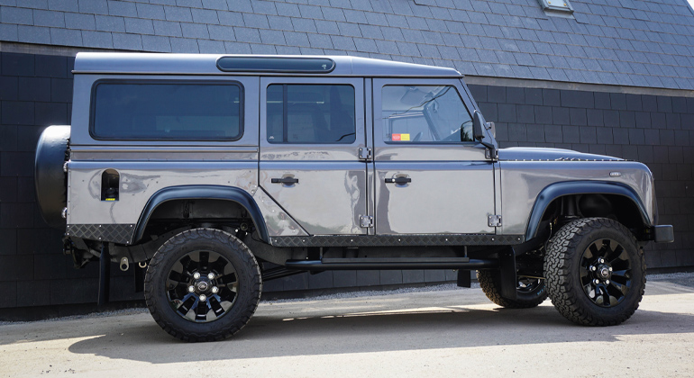 Side view of Arkonik grey Defender D110