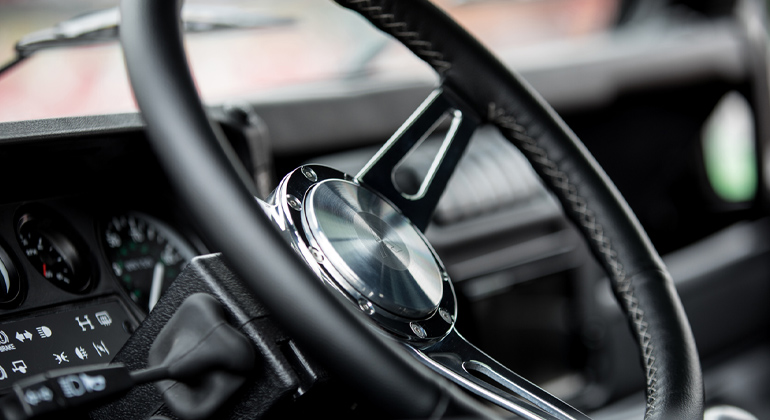 Arkonik steering wheel with silver spokes and black leather trim