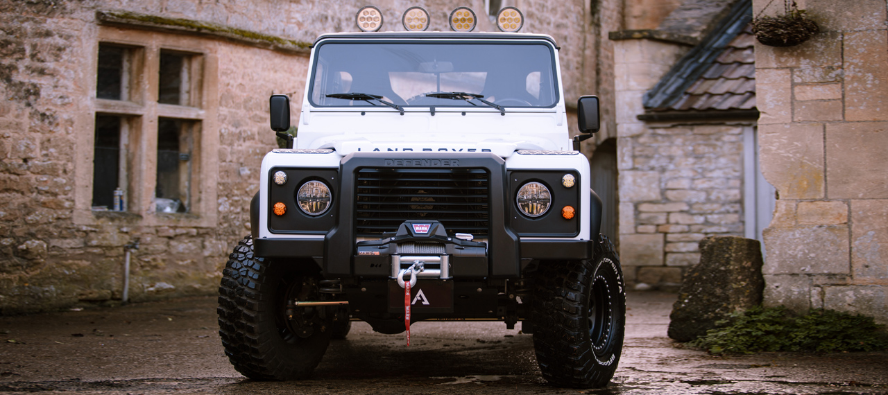 Front view of white Arkonik Defender pick-up