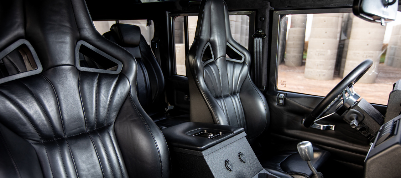 Elite Sports Defender seats in black leather