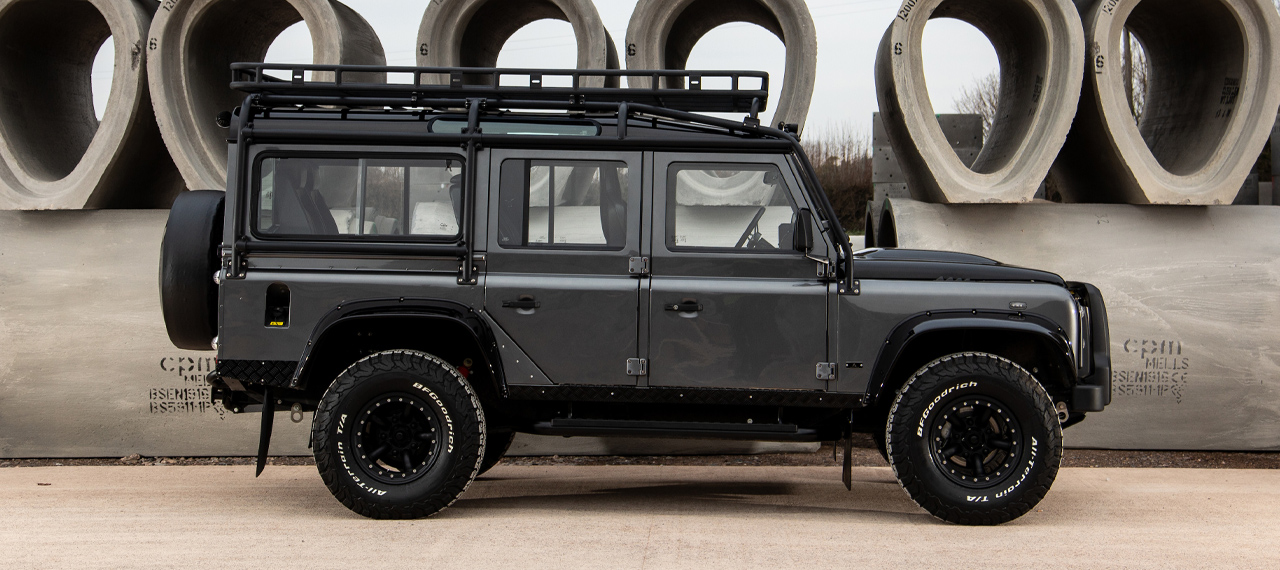 Side view of Corris Grey Defender with Java Black roof