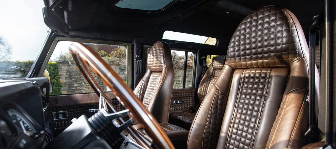 Brown modular Defender seats with chocolate box stitching