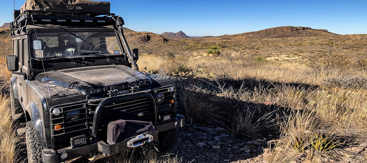 Land Rover Defender parked in Texas desert