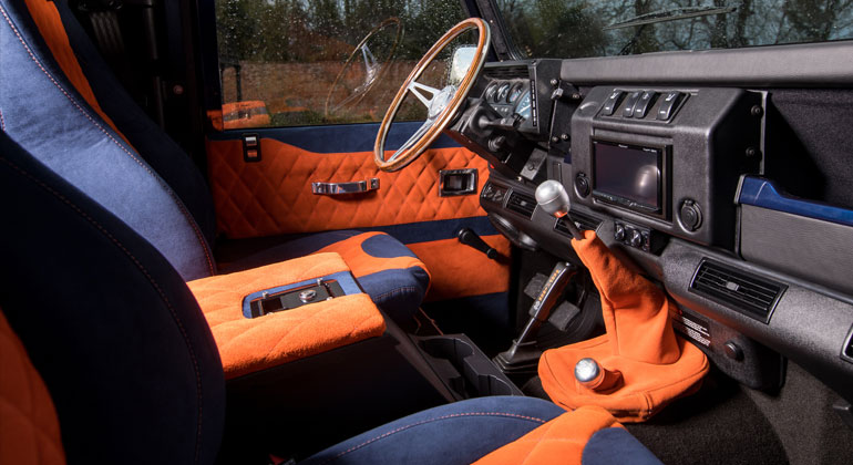 Defender interior with Blue Alcantara and Orange suede upholstery