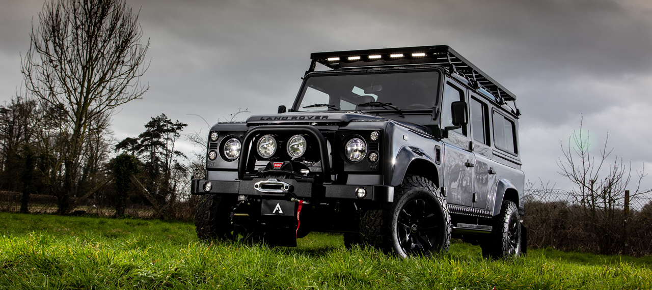 Front view of Bonatti Grey Defender 110 parked in a field