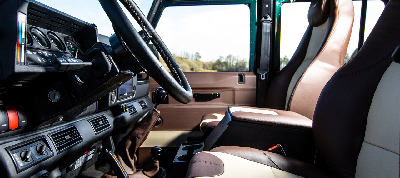 Defender with two-tone brown leather interior front seats