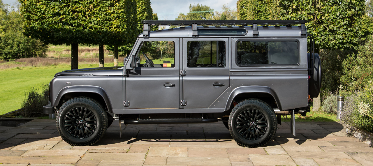 Side view of an Arkonik Bonatti Grey Land Rover Defender for sale