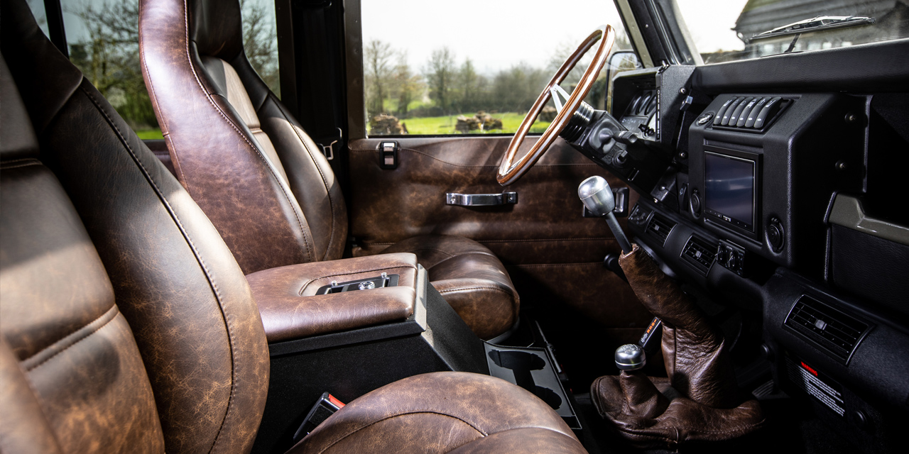 Interior view of Defender front seats and steering wheel