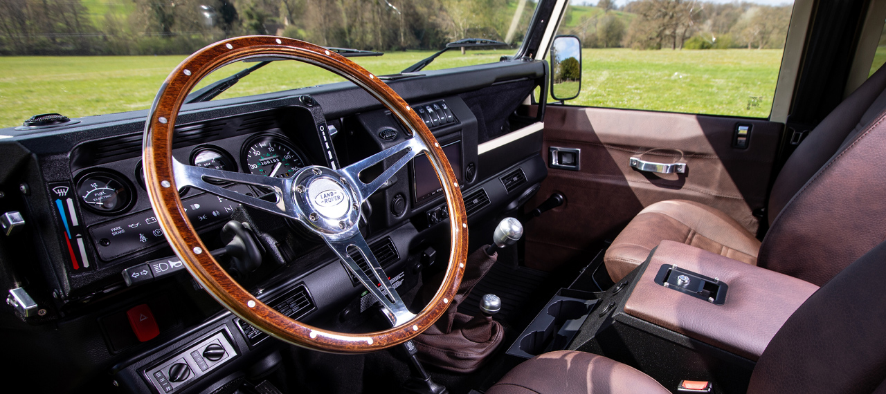 Wooden steering wheel inside a custom Arkonik Defender 110