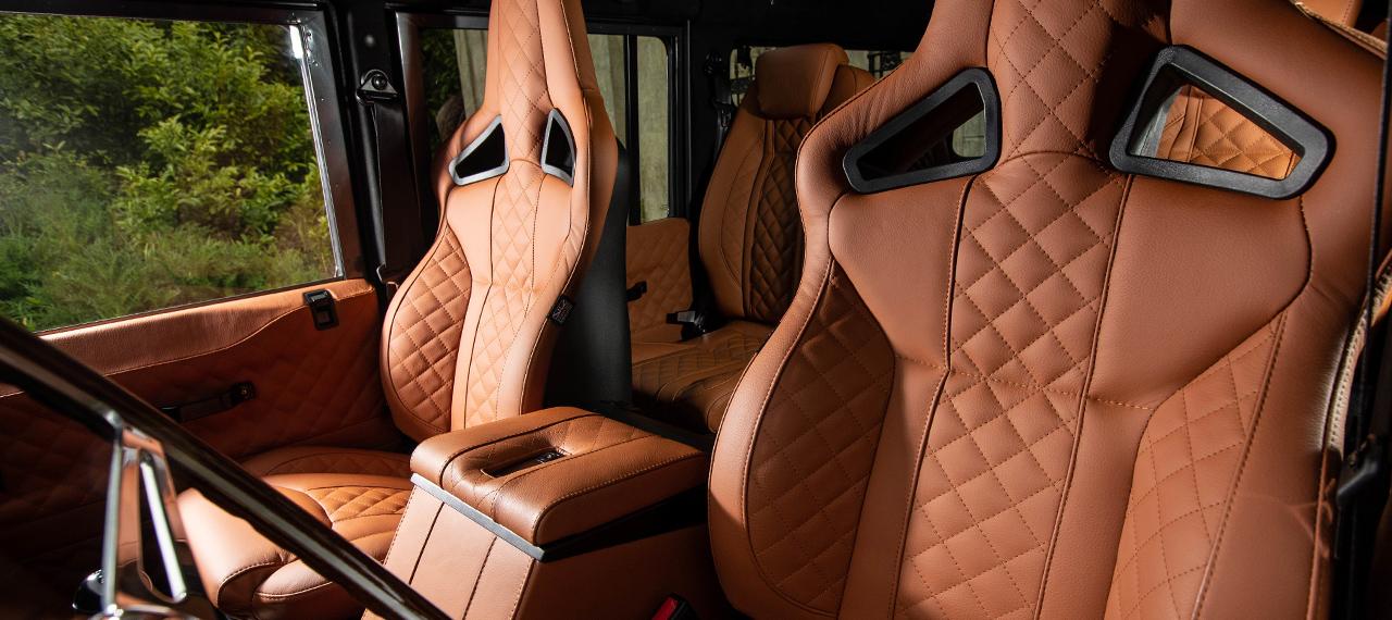 Defender orange leather interior with Elite sports seats