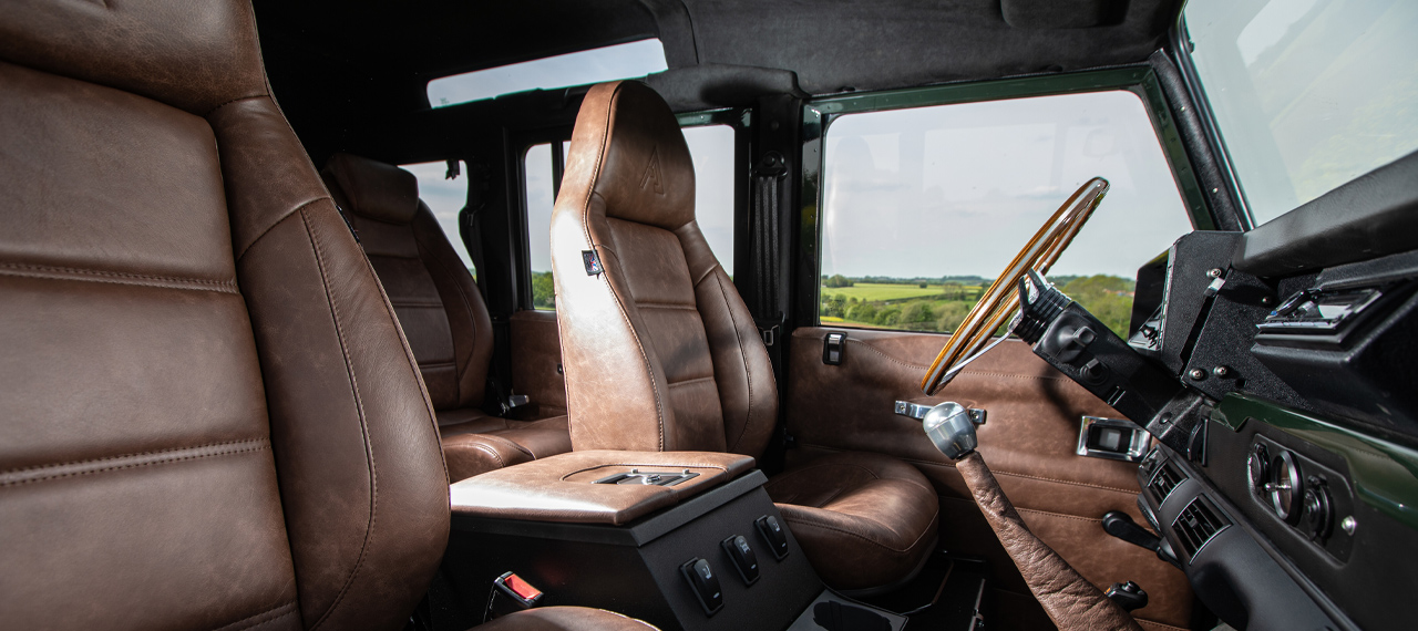 Brown leather interior front seats of OMEGA Defender 110