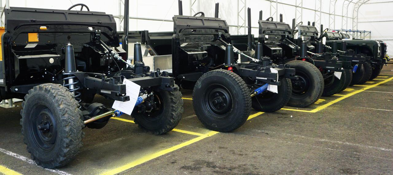 Row of Arkonik Defender chassis at Arkonik HQ