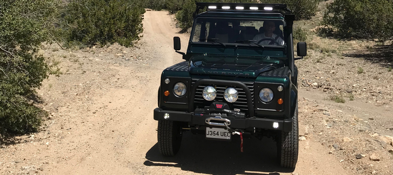 Front view of Navajo Defender 110 being driven off-road