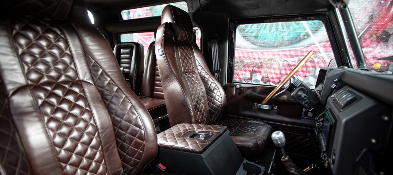 Interior front seats of Defender 90 in brown leather