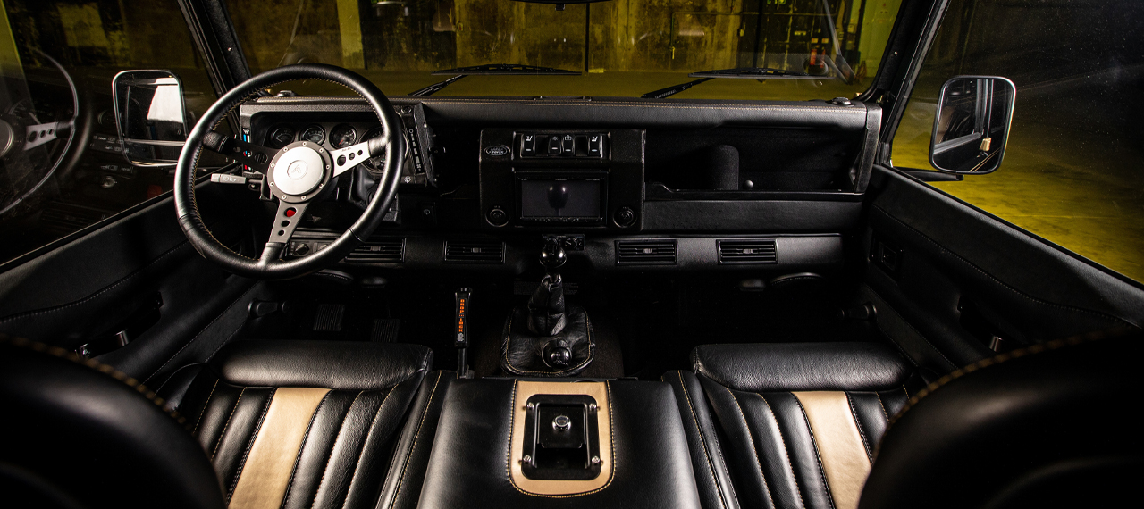 Black and gold leather interior of a Defender 110