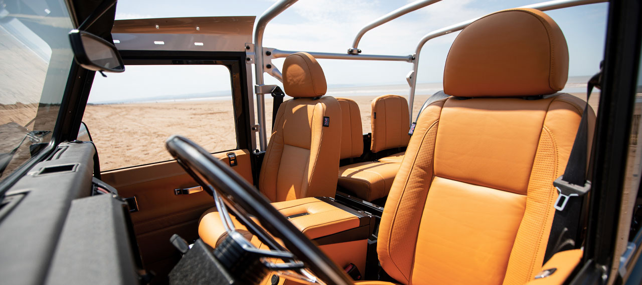 Leather interior of a Defender 90 with roof down