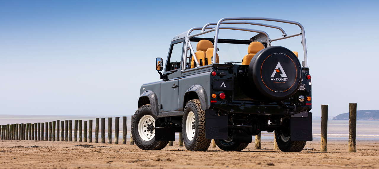 Rear view of 	Java Black Defender 90 on the beach